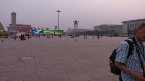Three red fire extinguishers stand at the ready in Tiananmen Square