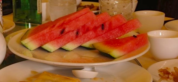 The watermelon has arrived.  The meal must be over.