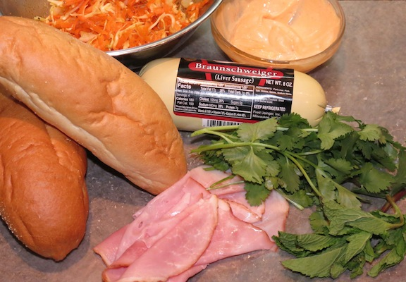 Mise en place:  bolillo, ham, liver sausage, Shriracha laced mayo, frresh pickled carrots and cabbage, cilantro and mint