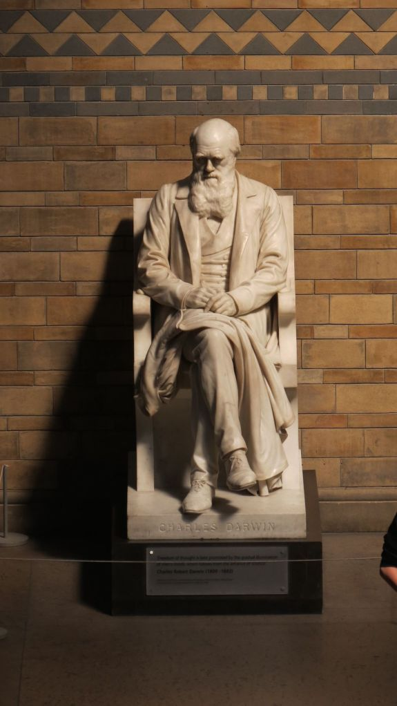Charles Darwin oversees it all.