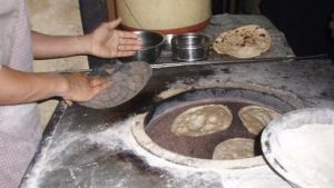 Making naan in a traditional tandoor oven