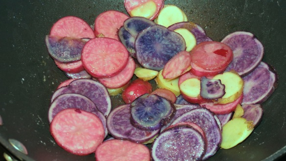 Potatoes, sliced and starting to fry