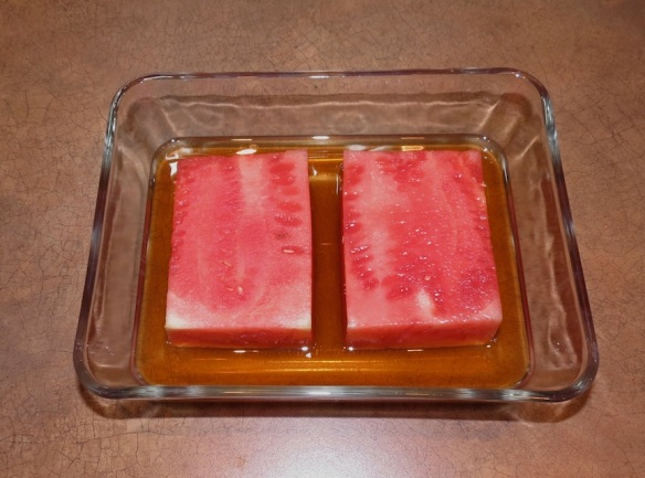 "Watermelon ""steaks"" marinating in sherry"