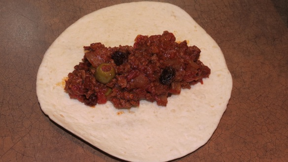 Fill tortillas with a geneous 1/4 cup of picadillo mixture