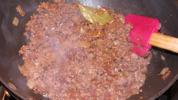 Beef, tomatoes, onions, chorizo, garlic and seasonings saute away